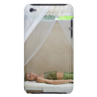 Woman wrapped in banana leaves at a spa in iPod touch covers