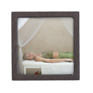 Woman wrapped in banana leaves at a spa in premium trinket box