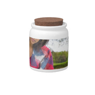 Woman writing in meadow with spring flowers candy jar