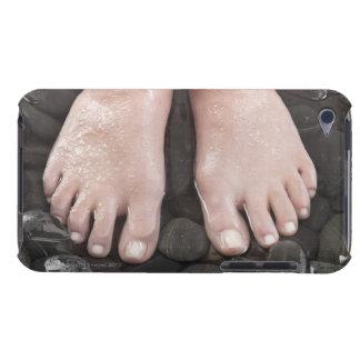 Woman's feet on pebbles iPod Case-Mate case