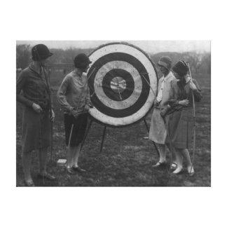 Women examining Archery Target Photograph Canvas Print