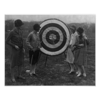 Women examining Archery Target Photograph Poster