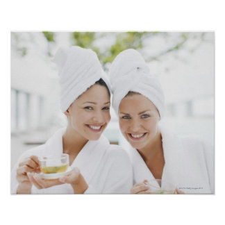 Women in bathrobes drinking tea at spa posters