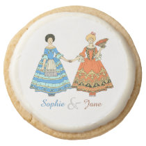 Women In Blue and Red Costumes Holding Hands Round Premium Shortbread Cookie at Zazzle