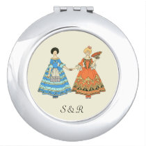 Women In Blue and Red Costumes Holding Hands Makeup Mirror at Zazzle