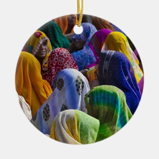 Women in colorful saris gather together ceramic ornament