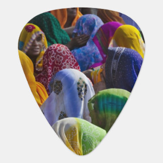 Women in colorful saris gather together guitar pick