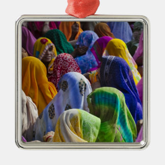 Women in colorful saris gather together square metal christmas ornament