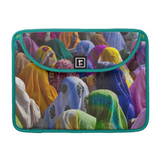 Women in colorful saris gather together sleeve for MacBook pro