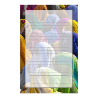 Women in colorful saris gather together stationery