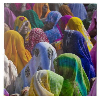 Women in colorful saris gather together tile