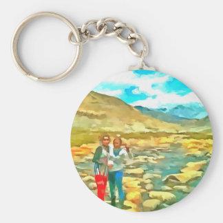 Women on a tocky mountain stream basic round button keychain