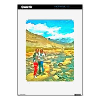 Women on a tocky mountain stream iPad skin