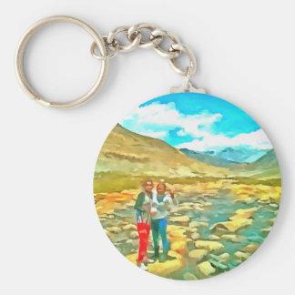Women on a tocky mountain stream keychain