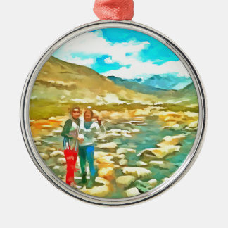 Women on a tocky mountain stream metal ornament