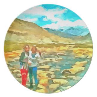 Women on a tocky mountain stream plate