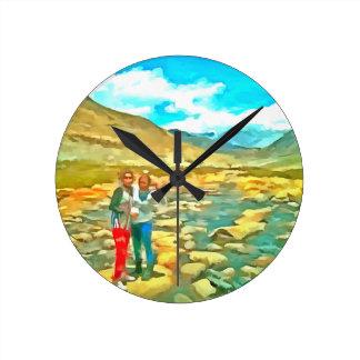 Women on a tocky mountain stream round clock