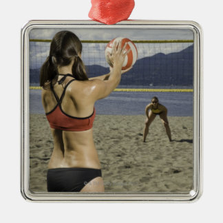 Women playing volleyball on beach metal ornament