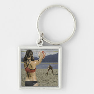 Women playing volleyball on beach Silver-Colored square keychain