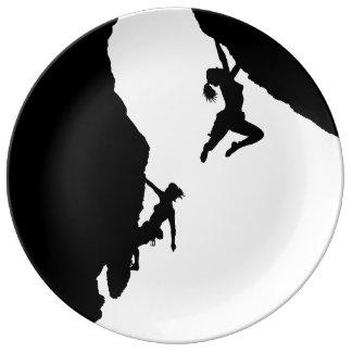 women rock climbing plate