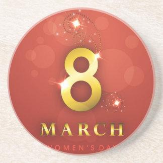 Women's day,golden words  on red bokeh background sandstone coaster