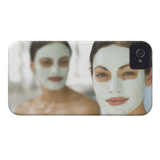 Women smiling in beauty mud masks iPhone 4 cover