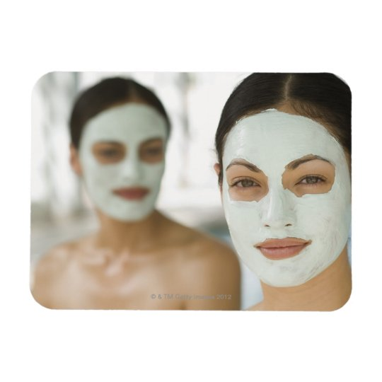 Women smiling in beauty mud masks magnet