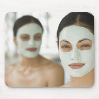 Women smiling in beauty mud masks mouse pad