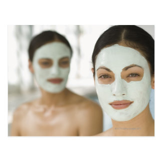 Women smiling in beauty mud masks post card