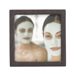 Women smiling in beauty mud masks premium jewelry boxes