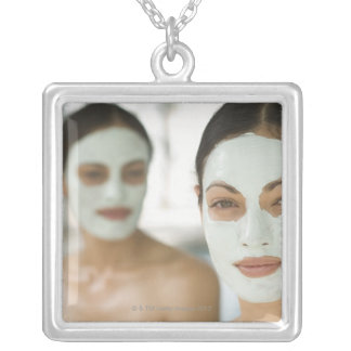 Women smiling in beauty mud masks square pendant necklace