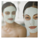 Women smiling in beauty mud masks large square tile