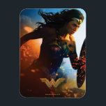 """Wonder Woman Running on Battlefield Magnet<br><div class=""""desc"""">Check out this iconic Wonder Woman movie poster art of Wonder Woman running through the battlefields,  sparks of ricocheted bullets and explosions seen all around.</div>"""
