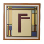 """Wonderful Arts &amp; Crafts Geometric Initial F Tile<br><div class=""""desc"""">Set your tea or coffee on this great coaster. It features a decorative Arts &amp; Crafts style letter F in bungalow fall colors. This style was in vogue at the turn of the century (last century) during the 1900&#39;s when William Morris, Stickley and Frank Lloyd Wright were working and it...</div>"""