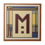 """Wonderful Arts &amp; Crafts Geometric Initial M Ceramic Tile<br><div class=""""desc"""">Set your tea or coffee on this great coaster. It features a decorative Arts &amp; Crafts style letter M in bungalow fall colors. This style was in vogue at the turn of the century (last century) during the 1900&#39;s when William Morris, Stickley and Frank Lloyd Wright were working and it...</div>"""