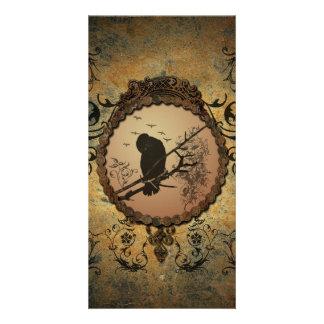 Wonderful bird in a circle made of rusty metal card