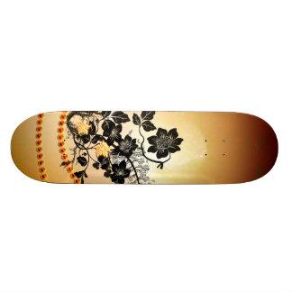 Wonderful black flowers skateboard