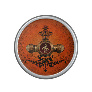 Wonderful golden clef on a awesome button speaker