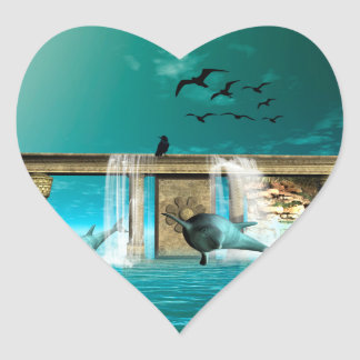 Wonderful playing dolphins in a fantasy world heart sticker