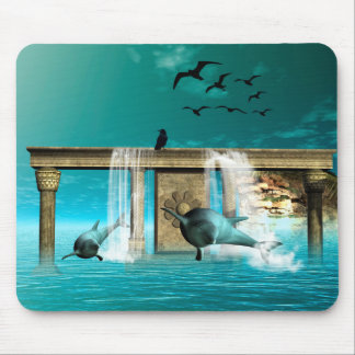 Wonderful playing dolphins in a fantasy world mouse pad