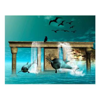 Wonderful playing dolphins in a fantasy world postcard