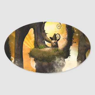 Wonderland in the universe with raven on a rock oval sticker