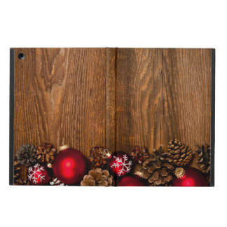 Wood background with Christmas ornaments iPad Air Cases