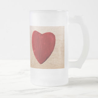 Wood background with heart frosted glass beer mug