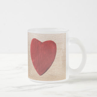 Wood background with heart frosted glass coffee mug