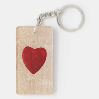 Wood background with heart keychain