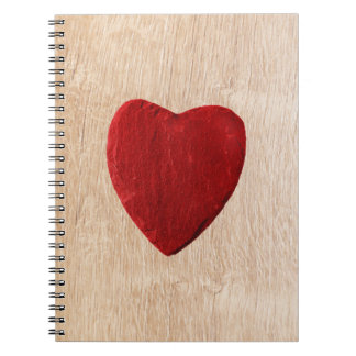 Wood background with heart spiral notebook
