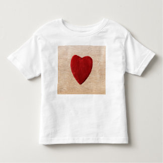 Wood background with heart toddler t-shirt