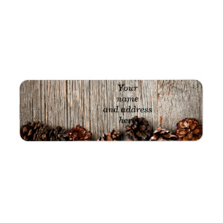 Wood background with pine cones return address label