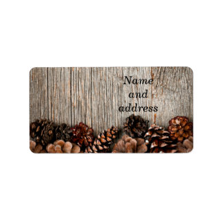 Wood background with pine cones address label